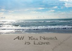 ALL YOU NEED is Love Sand Writing.