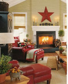 Cozy living room! Love the black entertainment center and the red furniture. Sweet!
