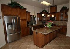 KraftMaid cognac maple kitchen.