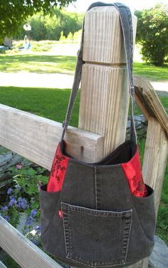 Recycled black denim tote bag with silky red Oriental accent fabric. 2 side…