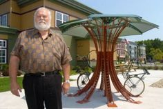 """""""While it's not super space-efficient, this tree-like bicycle rack is certainly a beautiful way to store bikes in public places. Designed and built in West Michigan by Vern Ohlman, the Bike Petal functions as both a practical bicycle rack and as an outdoor sculpture."""""""