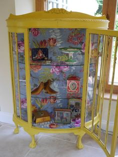 Yellow painted display cabinet
