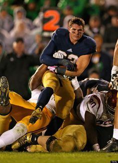 That's Cam McDaniel. He's a running back for the University of Notre Dame and yes, somehow, despite being pulled (helmetless!) into a dog pile during an Oct. 19 game against the University of Southern California, he looks like a movie star -- all smoldering eyes and charming half-smiles.