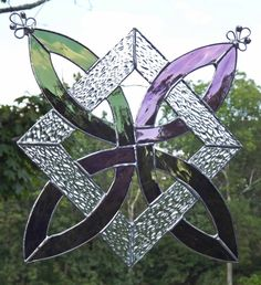 This Celtic Knot Stained Glass Suncatcher Panel is handcrafted from a textured clear art glass and an light olive green textured glass and