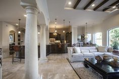 Mediterranean Great Room with Built-in bookshelf, can lights, complex marble tile floors, Standard height, Arched window