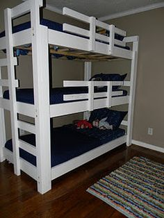 Operation Triple Bunk Bed:  My husband designed and made our three sons a triple bunk bed!  :)