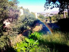 Incredible small rainbow into the Alhambra garden, Granada, Spain.