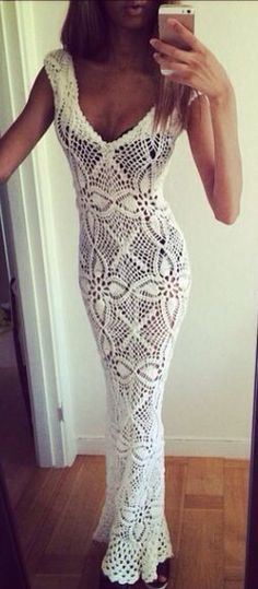 Pretty white crocheted dress, worn on a great figure. But why wear black underwear?!