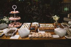 Oluwalu Plantation House Wedding Maui Hawaii Dessert Table Display Event Production and Catering: Celebrations Catering Maui Photography: Mike Adrian Decor: Rio Event Design Floral: Teresa Sena Designs