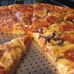 Mike's Homemade Pizza Allrecipes.com.  July 2015.  Perfect!  Made with Ina's roasted balsamic beet salad.  Super dinner.  Toppings: sausage, Canadian bacon, pepperoni, red onion, olives, mushrooms, with jack and cheddar cheeses.  SS