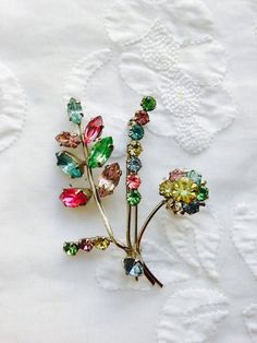 1950s Pastel Rhinestone Flower Brooch. Pink, Green, Purple, Yellow, Clear and Blue Rhinestones.  by Vintage0156 on Etsy https://www.etsy.com/listing/216534676/1950s-pastel-rhinestone-flower-brooch