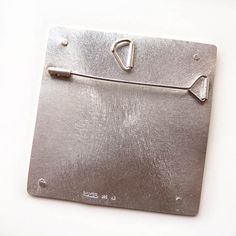 back side of pendant/ pin combo