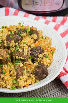 """Instant Pot Brown Rice Pilaf recipe is a healthy version of classic Plov, made with short grain brown rice and beef tips. It has a video tutorial with """"how to make"""" steps. This is the best one pot meal dinner idea that is easy to make. #instantpot #instantpotrecipes #brownrice #pilaf #beef #beefstewrecipes"""