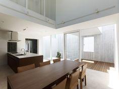 Takanawa House by Hiroyuki Ito -- island, table, & chairs