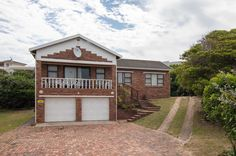 Ideal family home within walking distance from the beach. This home has a spacious lounge with a balcony overlooking the garden. The dining room flows into. Open Plan Kitchen, Cape, Home And Family, Lounge, Real Estate, Holidays, House Styles, Beach, Home Decor