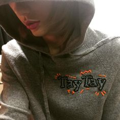 Jazz up your plain gray hoodie with this inspo from Taylor Swift.