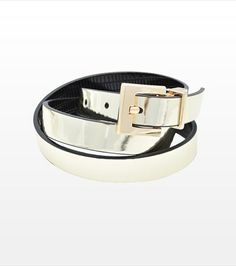 Get the best of both worlds! This reversible belt features a golden metallic side and a black side.