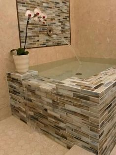 A tub that overflows into the shower!