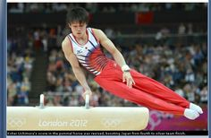 """301a: This photo features Japanese gymnast Kohei Uchimura competing. The photo is an action shot with a high shutter speed and low aperture. This makes the picture of the athlete look very clear and the crowd appear blurred. The athlete's nationality is clearly visible in the photo. The """"London 2012"""" writing is prominently featured in the photo, almost as if it's an advertisement."""