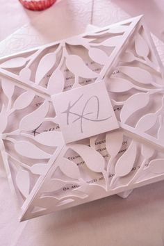 A modern wedding invitation in white with an impressive pattern from Biniatian See more http://www.love4weddings.gr/bridal-styled-shoot-with-victoria-kyriakides/
