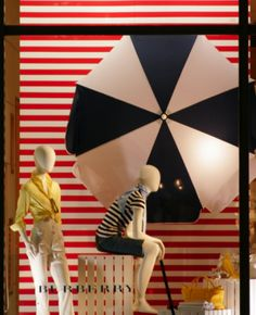 window display. This is actually a great idea, using a big outdoor umbrella in your creates an eye catching element to you window!