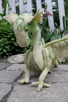 This beautiful dragon sewing pattern is for a completely hand sewn dragon from hand dyed wool-blend felt. His body is needle felted with swirling