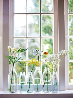 A great way to reuse milk bottles and mason jars. Decorate-with-flowers-p-89-gardenista