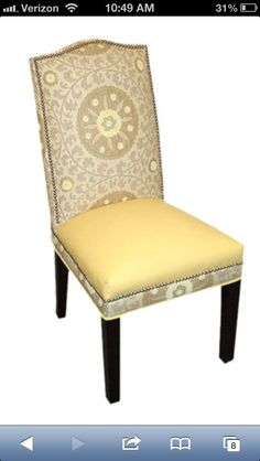 Love the multiple patterns on this slipper chair!