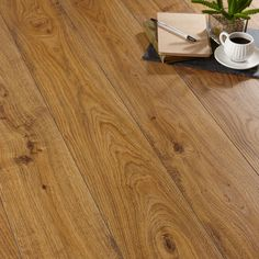 This laminate flooring has an attractive Oak effect finish and embossed surface finish. Each plank uses a simple click system, so installation is simple and it can be used with underfloor heating to keep your home warm.