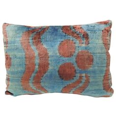 Vintage Uzbek Ikat Aqua Blue Silk Velvet Decorative Bolster Pillow   From a unique collection of antique and modern pillows and throws at https://www.1stdibs.com/furniture/more-furniture-collectibles/pillows-throws/