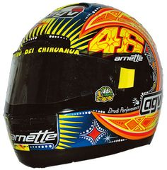 2002 - Possibly one of my favourite Valentino Rossi helmet designs is the primary helmet paint-job that he wore for the 2002 season.
