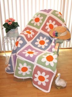 LOVE LOVE THIS! But would prefer pillows from the pattern instead of afghan. Flower Power Afghan.