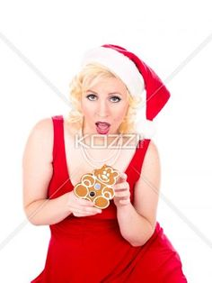 portrait of a young woman holding christmas cookie. - Portrait of a young woman holding christmas cookie against white background, MUA and Model: Amanda Wynne www.awynnemakeup.com