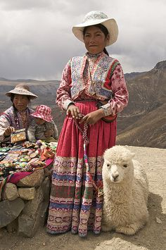 A dignified Peruvian with an alpaca by my side, and a little family.