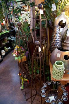 set of three dark brown metal topiary forms with geometric design
