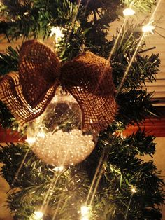 Christmas ornament with pearls inside and burlap bow. Make matching button one. And a wedding craft material one!