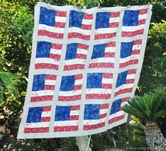 American Flag Quilt - FREE TUTORIAL  -75x75 - made with blue batik, red bandana print, white with pale flowers...really cute!