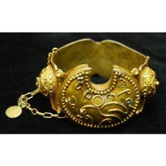 Bracelet (galbe, lam u teg) Date: Early to mid-20th century Medium: Gilt copper (gold wash) Dimensions: H x W x D: 7.2 x 7.9 x 1.3 cm (2 13/16 x 3 1/8 x 1/2 in.) Credit Line: Gift of Dr. Marian Ashby Johnson Geography: Senegal