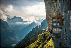 As lovely vacation destinations go, the un-pronounceable name of Berggasthaus Aescher-Wildkirchli is quite the place to be. The 170 year old hotel stands sticking to the face of a vertical cliff face and can only be reached by a combination of cable car and hiking.