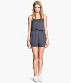 Playsuit in jersey with narrow shoulder straps, short legs and an elasticated seam at the waist.