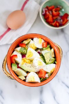 Hardboiled Egg and Avocado Bowl Great snack and wonderful served with a rice cake or some toast.  I used only three egg whites per serving 1/2 tsp of minced shallot per serving and about 1/8 c diced red peppers per serving