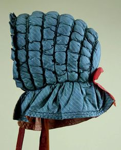 Quilted blue silk bonnet, American, c. 1840s.