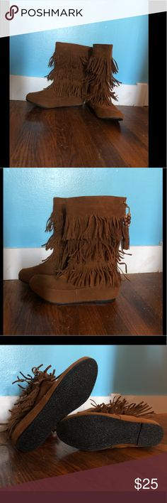 Fringe boots with wooden bead tassels Fringe boots with wooden bead tassels   - these boots feature brown faux leather with faux leather Fringe and wooden bead tassels   - these boots are brand new without tags *i know the tag says that these boots are a size 11 they are definitely a size 10 COMES FROM A DOG AND SMOKE FRIENDLY HOME Shoes Moccasins