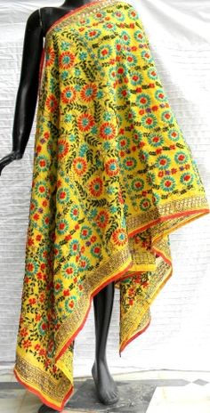 Steal the show at the next party you attend in this stunning phulkari work chanderi dupatta. It has been embroidered in a vibrant colored floral pattern