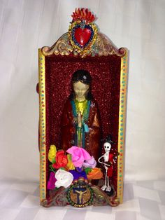 Lady of Guadalupe shrine made from a cigar box.