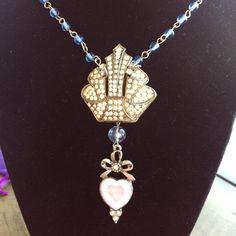 Display of unique rhinestone brooch necklace