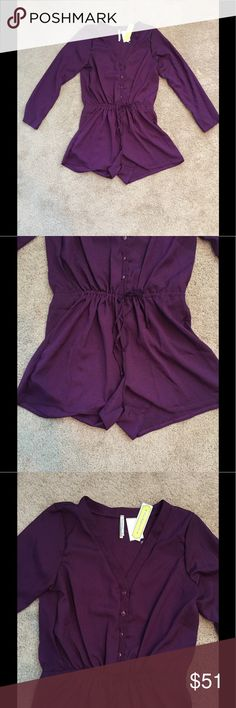 S.H.E. Purple Romper V-neck, partial button front closure, long sleeves, self-tie drawstring waist. Made in USA. 100% polyester. Machine wash. S.H.E. Pants Jumpsuits & Rompers