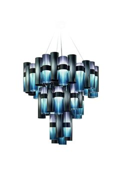 LA LOLLO is now available in stores!  A tribute to the roaring Fifties, to divas and to the leading Italian star #ginalollobrigida, La Lollo -featured here in its Gradient color - is a system of lamps ranging from a 48 cm in diameter to this opulent chandelier (80 cm in diameter).  The patented, techno-polymer cylinders, in shades of contemporary prismatic metallization, alternate around a central ring which hides the LED source. Discover the whole collection at www.slamp.com