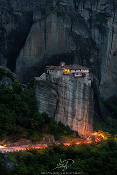 Almost night over Holy Monastery of Roussanou at Meteora, Greece. Sitting on the edge of another cliff like this and with a flashlight on my forehead ,(as it was almost pitch black night), i waited patiently ,with a friend, for a car to pass by, ..with no much luck. Thankfully 2 motorcyclists rolling slowly downward, while talking to each other, gave me this 60sec long exposure with enough light to light the rock ;)