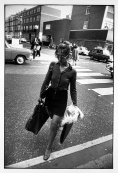 garry winogrand, Untitled (Woman with Purse and Portfolio Crossing the Street), from Women are Beautiful Series
